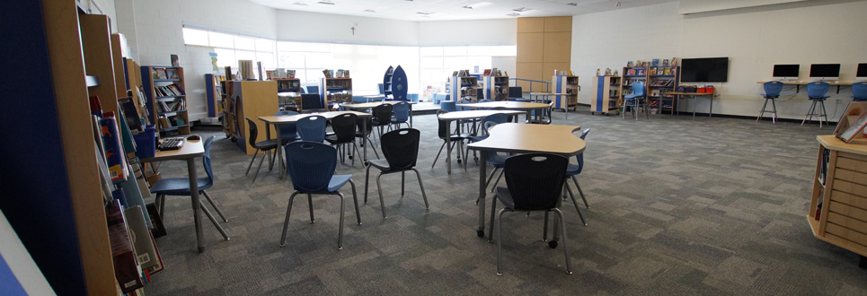 Empty library with tables and chairs.